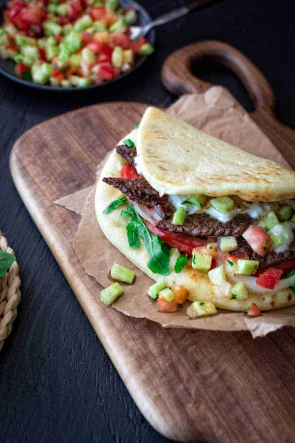 beef sandwich on naan bread