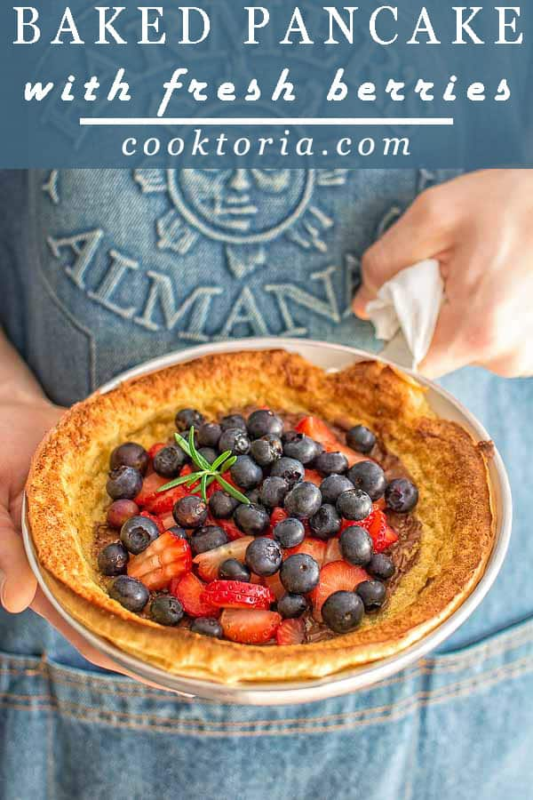 Fluffy and moist oven baked pancake topped with a spoonful of Nutella and some fresh berries. ❤ COOKTORIA.COM