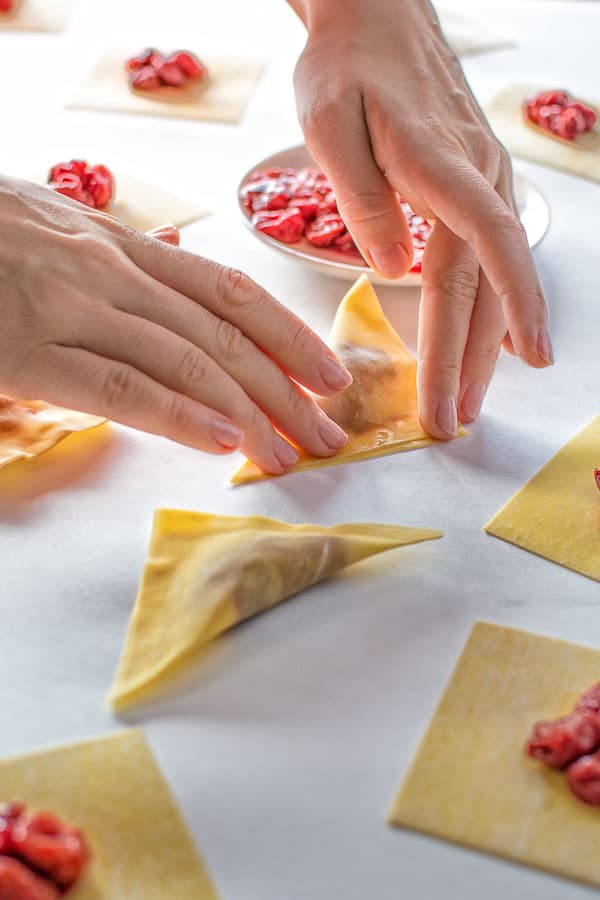 The easiest cherry dumplings made with wonton wrappers, frozen cherries and a special cherry sauce. ❤ COOKTORIA.COM