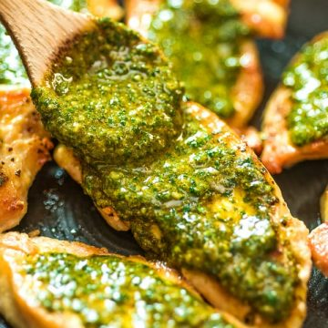 spreading Chermoula Sauce on top of chicken