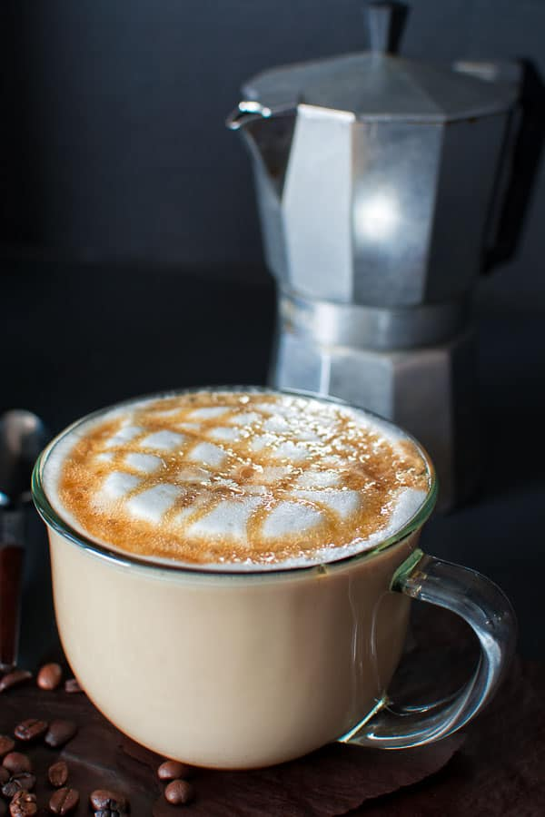 Try this homemade recipe of the most popular Starbucks drink – Caramel Macchiato! Lightly sweetened vanilla milk mixed with smoky (homemade!) espresso and topped with buttery caramel sauce!  ❤ COOKTORIA.COM