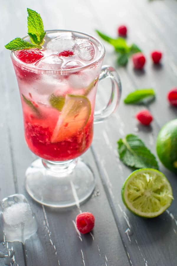 This refreshing Non-Alcoholic Raspberry Mojito is what you need on a hot summer day. A combination of fresh raspberries, mint, lime juice, sparkling soda and a hint of sweetness will make you crave for more! ❤ COOKTORIA.COM
