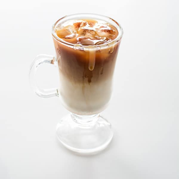 Prepare the loved-by-everyone Starbucks Iced Caramel Macchiato at home! I'll share the tips and the secrets on how to make this delicious treat. ❤ COOKTORIA.COM
