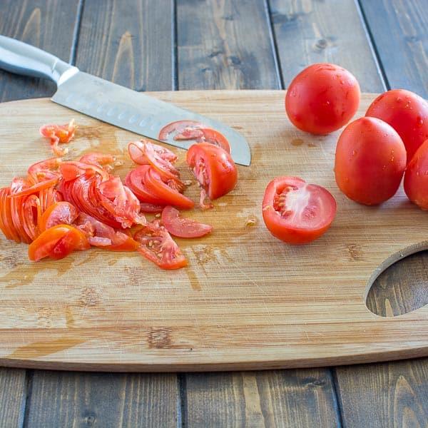 Slicing tomatoes for Uzbek Tomato Salad
