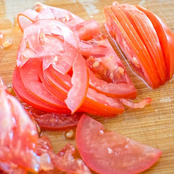 Close up image of very thinly sliced tomatoes