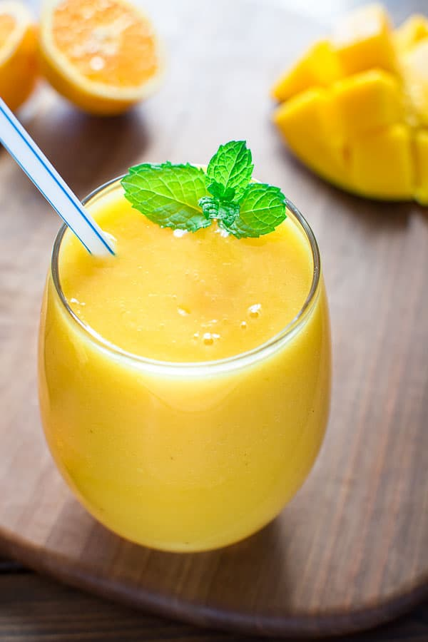 Quick, healthy and dairy-free, this Orange Mango smoothie will become ...
