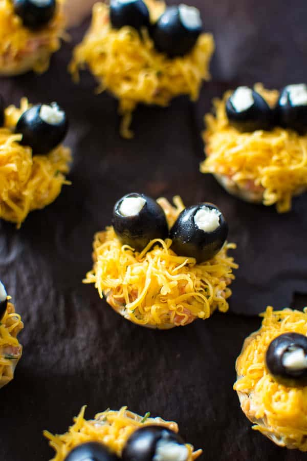 Mini fillo shells stuffed with tasty cheese salad and garnished with olives, make these cute Halloween Cheese Cup monsters. ❤ COOKTORIA.COM