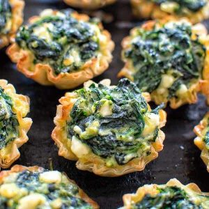 Make these adorable and delicious Easy Spanakopita Bites and surprise your guests and family with a new twist on a traditional Greek dish.