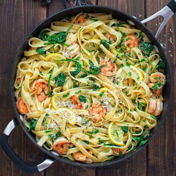 This Fettuccine with Shrimp and Spinach makes an easy and tasty weeknight dinner. With a hint of lemon and Parmesan cheese, it will please the whole family! ❤ COOKTORIA.COM