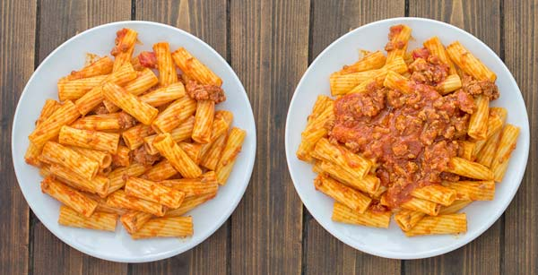 arranging rigatoni bolognese on plates