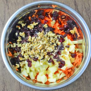 This easy to make, flavorful and healthy Shredded Carrot Salad, packed with cranberries, apples and toasted walnuts is loved by kids and adults!