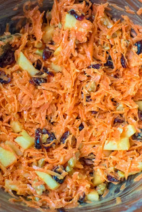 This easy-to-make, flavorful, and healthy Shredded Carrot Salad — packed with cranberries, apples, and toasted walnuts — is loved by both kids and adults!