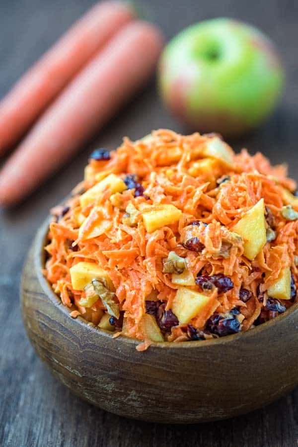 This easy-to-make, flavorful, and healthyShredded Carrot Salad — packed with cranberries, apples, and toasted walnuts — is loved by both kids and adults!