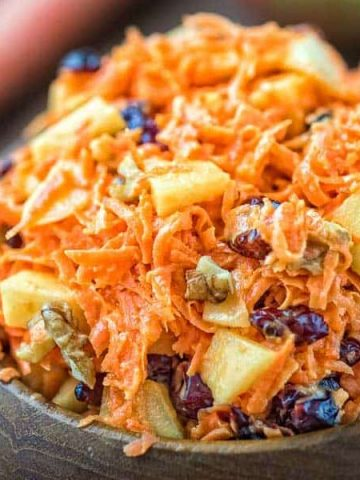 This easy-to-make, flavorful, and healthyShredded Carrot Salad — packed with cranberries, apples, and toasted walnuts — is loved by both kids and adults! ❤ COOKTORIA.COM