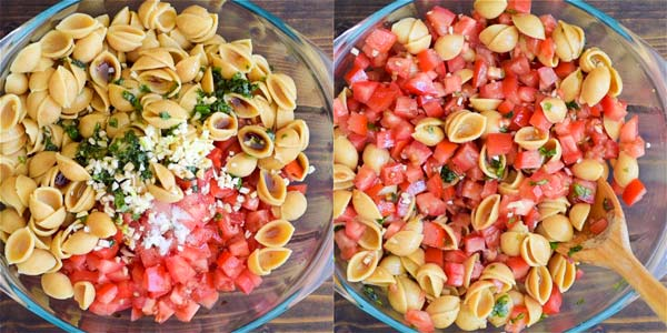 Mixing bruschetta pasta salad in a bowl