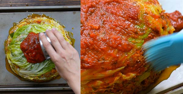spreading marinara on cabbage lasagna