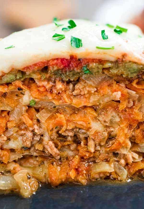 This Cabbage Lasagna is filled with sweet onions, carrots, juicy ground meat, and melted cheese. Topped with marinara sauce and some extra cheese, this dish tastes as impressive as it looks!