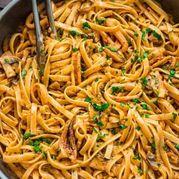 Tender calamari rings cooked in flavorful mushroom and roasted pepper sauce, and mixed with fettuccine pasta. This Creamy Calamari Fettuccine is my favorite seafood dish!