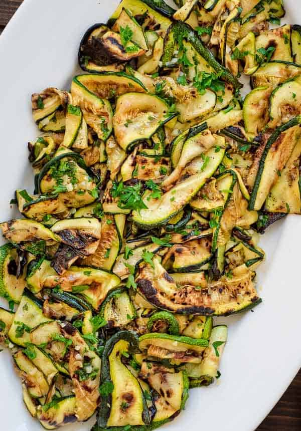 This Ultimate Zucchini Salad is so flavorful and healthy, you'll want to make it all summer long! Seasoned with lemon-parsley dressing, it requires only 5 ingredients!