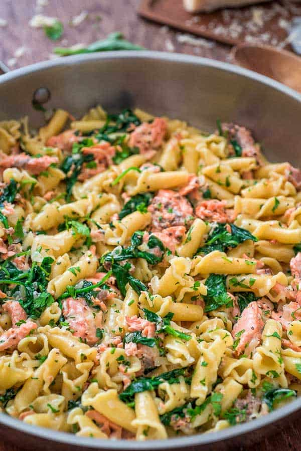This Salmon Pasta with Spinach is a deliciously easy pasta recipe with chunks of tender salmon, spinach in a scrumptious creamy Parmesan sauce!