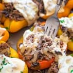 These Philly Cheesesteak Stuffed Peppers are cute, filling, and delicious! Colorful bell peppers stuffed with tender beef steak, sweet onions, mushrooms and rice.