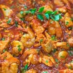 Salmon fillets and shrimp cooked in a tomato sauce with onions, garlic, and fresh herbs. This Italian Fish Stew makes an easy and scrumptious dinner, and comes together in less than 30 minutes.  ❤ COOKTORIA.COM