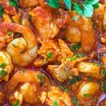 Salmon fillets and shrimp cooked in a tomato sauce with onions, garlic, and fresh herbs. This Italian Fish Stew makes an easy and scrumptious dinner, and comes together in less than 30 minutes.❤ COOKTORIA.COM