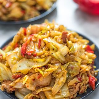 This Fried Cabbage recipe is insanely good! Made with bacon, onion, bell pepper, and a touch of hot sauce, it is easy to make, simple, and comes out perfect every time!
