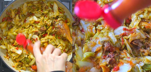 adding hot sauce to the fried cabbage