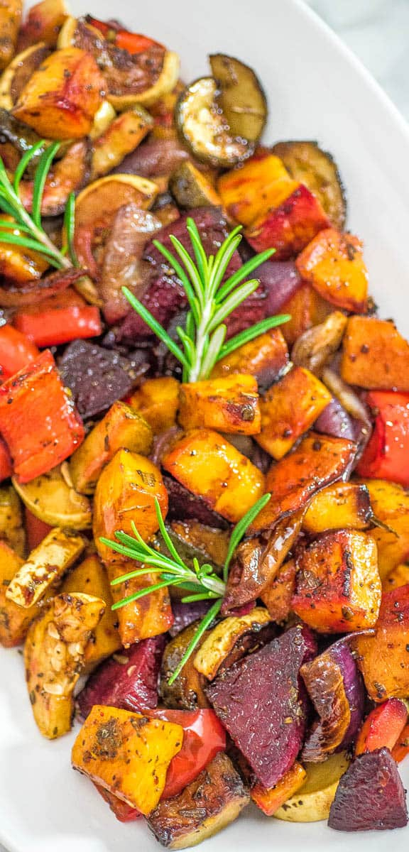 This is the easiest, simplest, and tastiest Oven Roasted Vegetables you'll ever try. Perfectly seasoned and colorful, they are healthy and full of flavor! ❤ COOKTORIA.COM #vegetables #fall #vegan #vegetarian #healthy