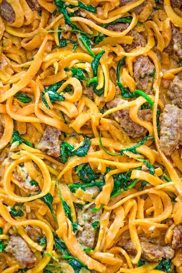 You are going to fall in love with these Butternut Squash Noodles with Sausage! Made with Italian sausage, spinach, spiralized butternut squash, garlic, cream, and Parmesan cheese, this dish is just bursting with flavors!