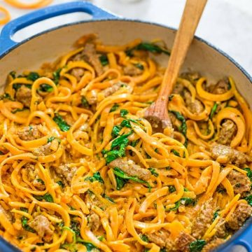 You are going to fall in love with theseButternut Squash Noodles with Sausage! Made with Italian sausage, spinach, spiralized butternut squash, garlic, cream, and Parmesan cheese, this dish is just bursting with flavors!