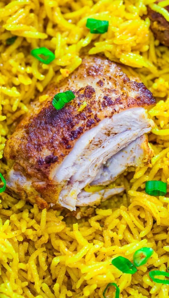 This easy and flavorful Chicken and Yellow Rice Skillet makes a quick and delicious dinner for the whole family. This is a MUST TRY recipe. #chicken #dinner #easydinner #rice #recipeoftheday