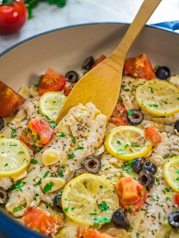 This incredibly delicious and healthy Cod Fish Skillet is going to become your favorite dinner! Create a taste of the Mediterranean with this simple, yet elegant meal.