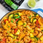 This Easy Shrimp and Vegetable Skillet makes a healthy, quick, and delicious dinner! Packed with wild-caught shrimp, tender zucchini, and sweet bell peppers, it is going to become your favorite seafood dish!#recipe #shrimps #seafood #dinner #lunch #mealprep