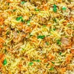This simple and easy Chicken Rice Casserole makes an elegant and tasty dinner. Made with onions, carrots, basmati rice, and chicken you won't believe how delicious this meal is!