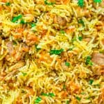 This simple and easy Chicken Rice Casserole makes an elegant and tasty dinner. Made with onions, carrots, basmati rice, and chicken you won't believe how delicious this meal is! #chicken #rice #dinner #casserole #recipeoftheday #cooktoria