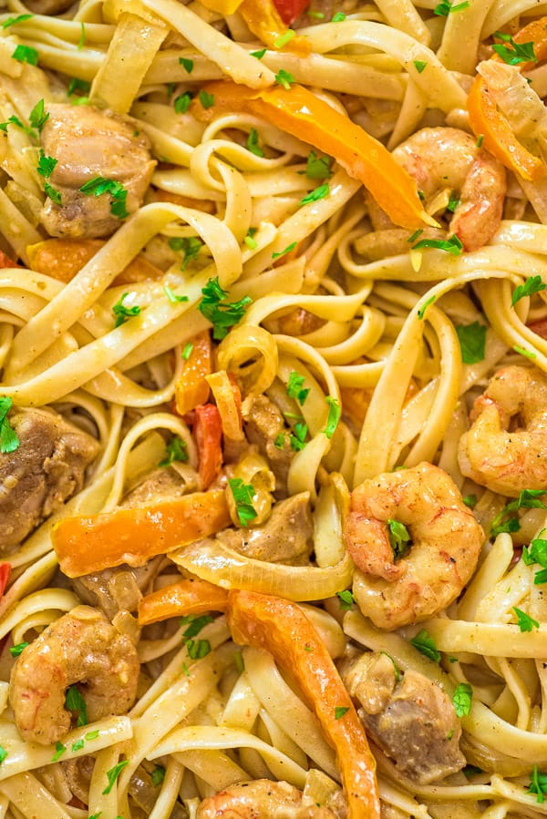 This delicious Cajun Chicken and Shrimp Pasta makes an easy, quick and filling dinner for the whole family. The smoky Cajun spice and the creamy Parmesan sauce create an unforgettable combination!