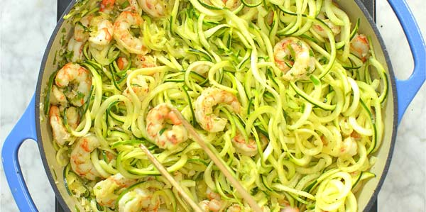 adding spiralized zucchini to shrimp scampi