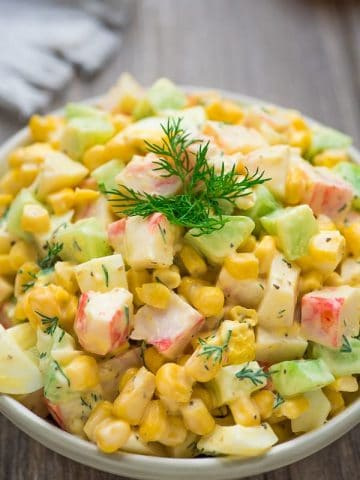 Imitation Crab Salad – quick and easy crab salad made with crunchy cucumbers, sweet corn, and hard-boiled eggs. Perfect for lunch, dinner, or on a sandwich!