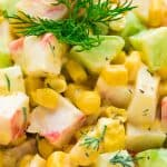 Imitation Crab Salad – quick and easy crab salad made with crunchy cucumbers, sweet corn, and hard-boiled eggs. Perfect for lunch, dinner, or on a sandwich! #crab #salad #sandwich #corn #cucumber #eggs #recipeoftheday