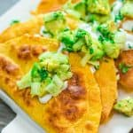 Potato Tacos on the plate, topped with avocado salsa