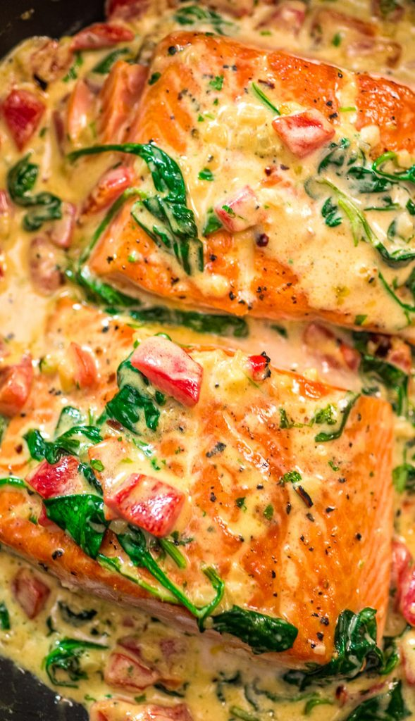 This Salmon in Roasted Pepper Sauce makes an absolutely scrumptious meal, worthy of a special occasion. Make this easy one-pan dinner in just 20 minutes! #salmon #dinner #creamy #keto #spinach #lowcarb #recipeoftheday