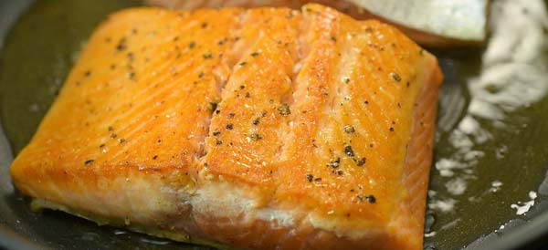 frying the salmon in the skillet