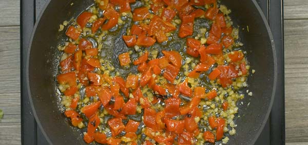 cooking roasted peppers with garlic