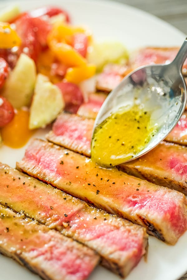 Pouring Maple Sauce over Ahi Tuna Steak