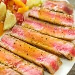Slices of Ahi Tuna Steak drizzled with Maple Sauce on a plate