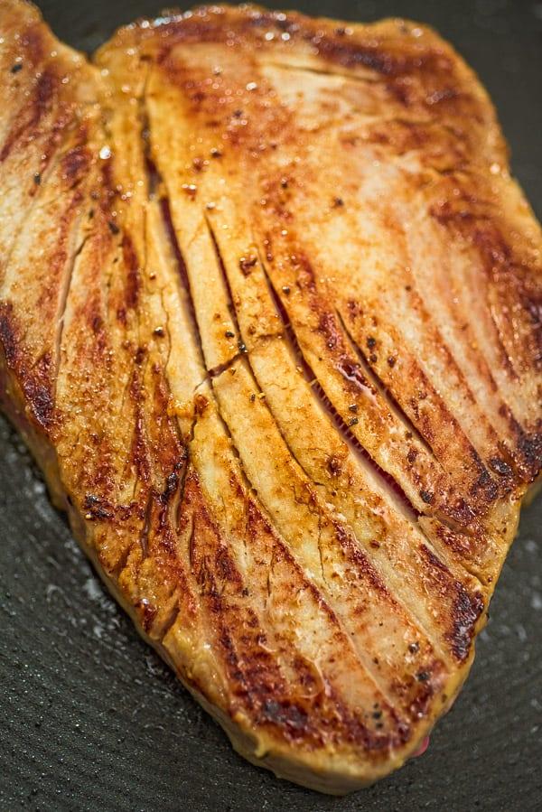 Ahi Tuna Steak searing in a pan