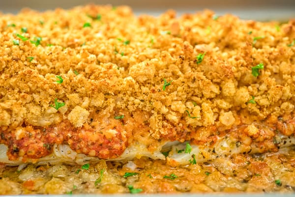 Baked Cod on a tray topped with breadcrumbs