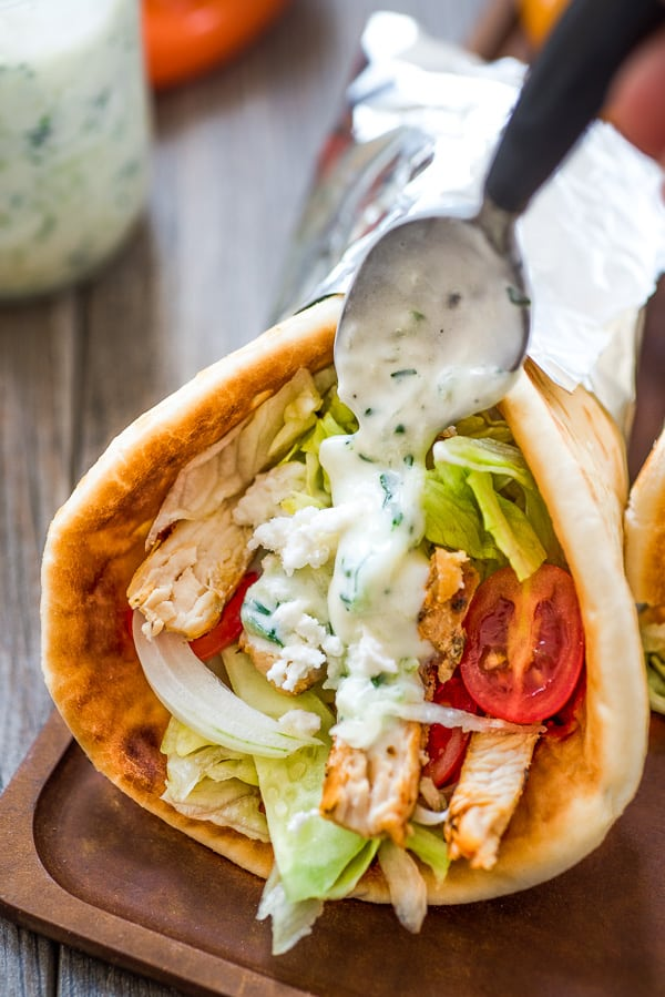 Chicken Gyro is drizzled with tzatziki sauce